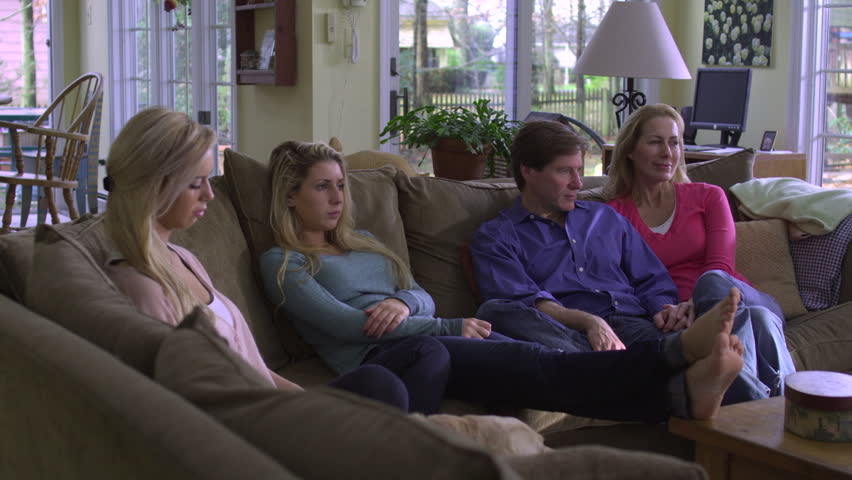 Same Sex Couple Family Watching Tv On Sofa Stock Footage -8292