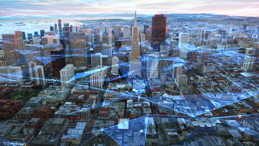 Futuristic aerial view of San Francisco financial district during sunset. Connected city. Technology network concept. California, United States. Shot from a helicopter.