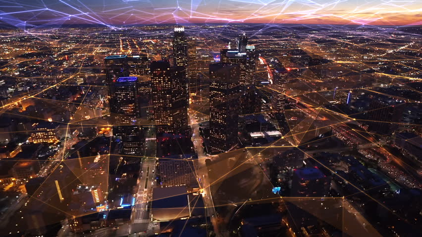 Connected aerial view of the Financial District in Downtown Los Angeles, California.  Sunset. Famous skyscrapers and freeway full of cars. Futuristic. Technology. Shot from helicopter.  | Shutterstock HD Video #26496299