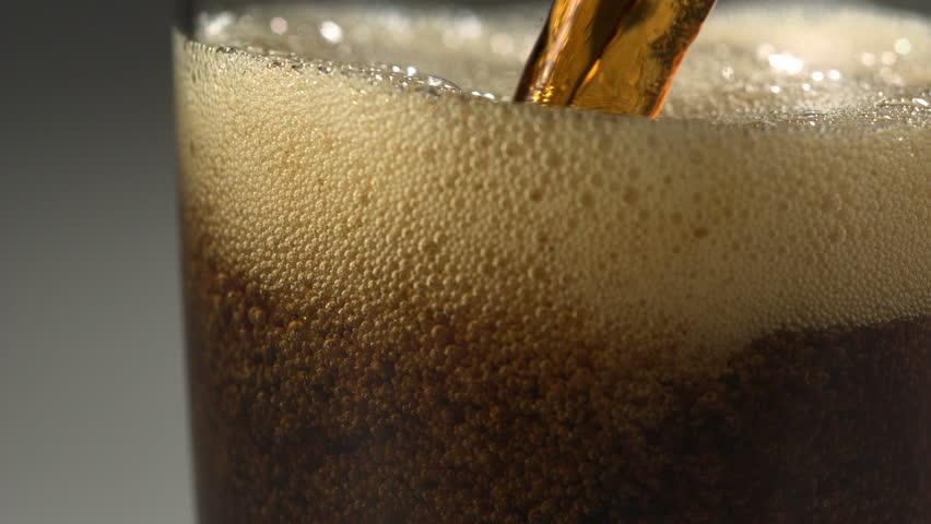 Pouring soft drink into glass shooting with high speed camera, phantom flex.