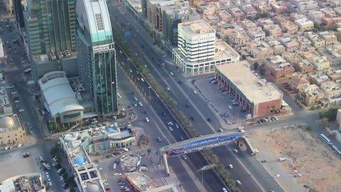 RIYADH, SAUDI ARABIA - OCTOBER 15, 2015. View on traffic jam on the road of Riyadh, Saudi Arabia. View from observation deck of Al-Mamlyaka Kingdom Tower