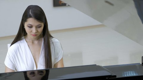 Piano music pianist playing. Musical instrument grand piano details 4K