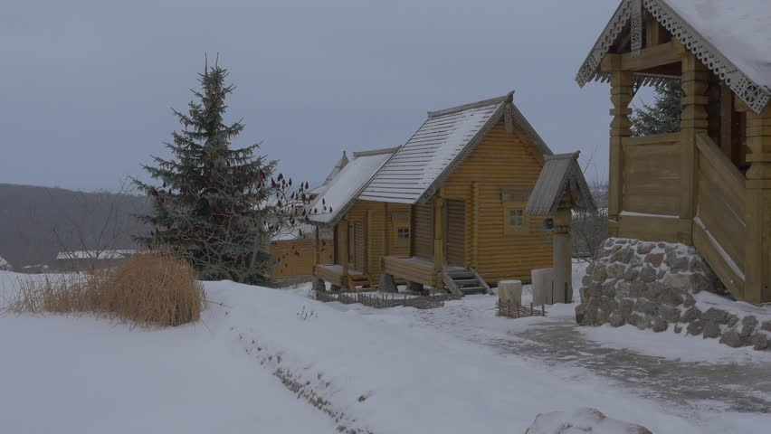Rustic Cottages, Ancient Slavic Houses At Winter Landscape. Two Storeyed  And One Storeyed Wooden
