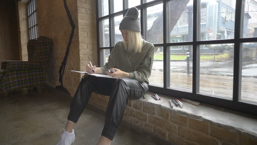 Young freelance fashion designer making sketches for the new clothing collection.in studio | Shutterstock HD Video #26637229