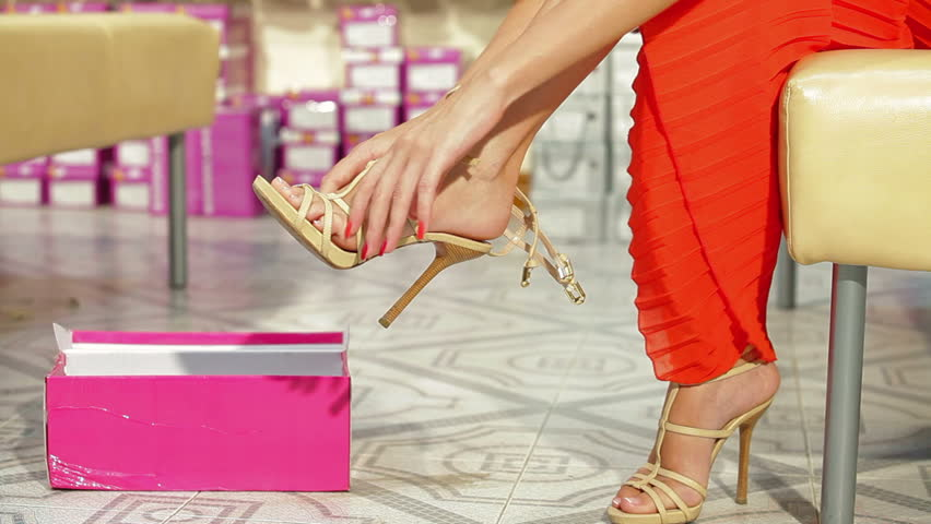 Young Woman Trying On High Heels In Shoe Store - HD stock footage clip - Young Woman Trying On High Heels In Shoe Store Stock Footage Video