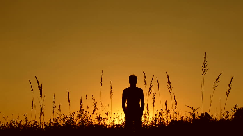 Silhouette of man on the sunset. Harmony concept.