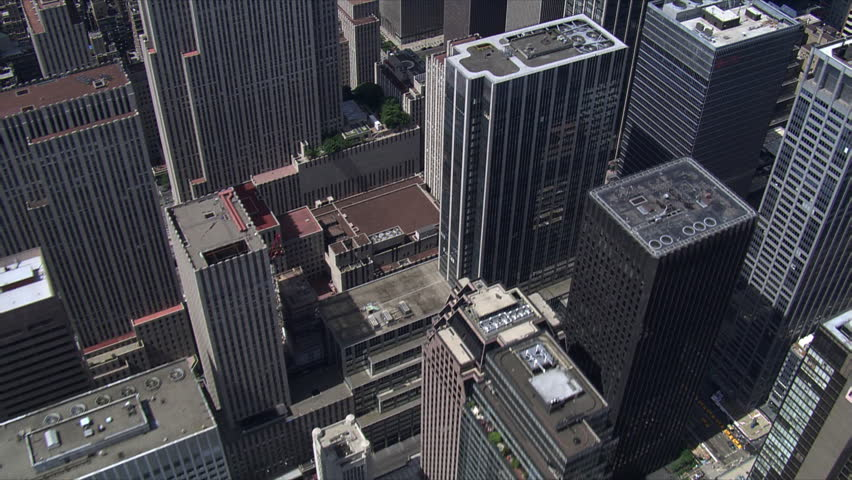 Diagonal flight above Manhattan buildings toward Times Square. Shot in 2006.