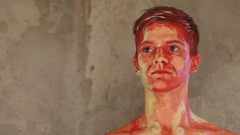 Alive painting of a man. Realistic oil paint body art
