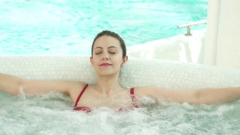 young woman in Jacuzzi. Spa treatments.