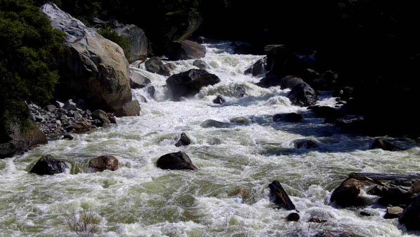 The Merced river in Yosemite Valley with raging whitewater rapids is a favorite of rafters.