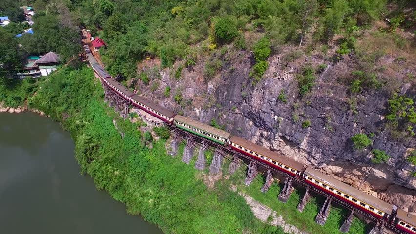 Aerial view Death Railway cave Krasae, Thai Train on River Kwai Bridge Kanchanaburi, Thailand. Top View