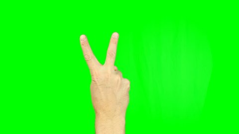 Victory sign hand gesture on green screen. Simbol of victory and peace emotion. Footage contains solid green instead alpha channel easy keying. Male hand victory sign gestures. Two fingers up.