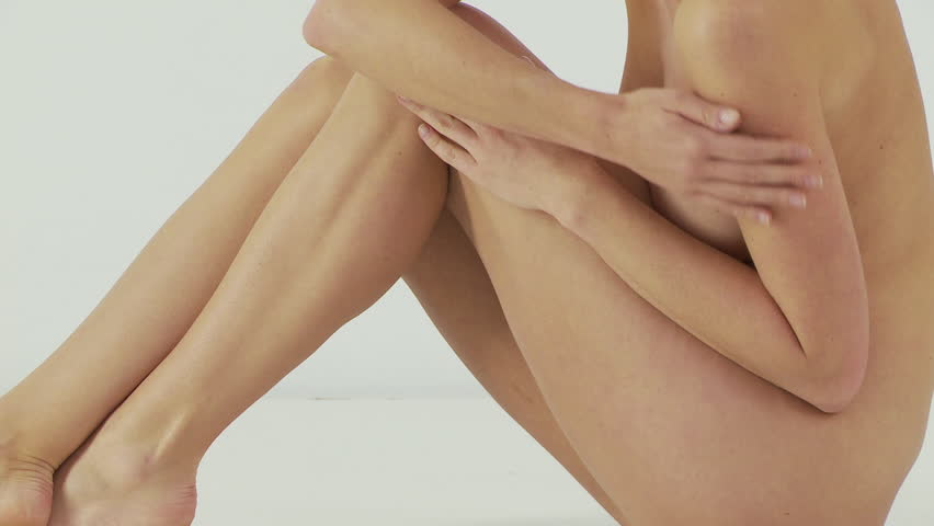 Woman sitting and rubbing legs