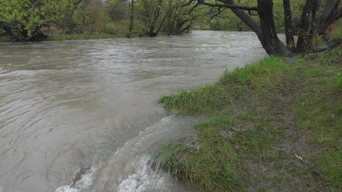Slow motion shot of flooded Don River during heavy rain. Spring in Toronto.