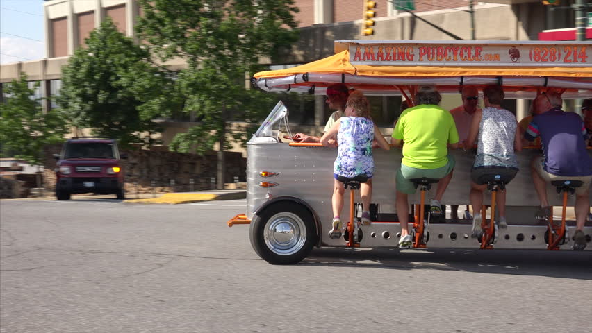 ASHEVILLE, NORTH CAROLINA - JUNE 24th: The Asheville PubCycle, a combination bar and street vehicle pedaled by its patrons in Asheville, North Carolina on June 24th, 2016.