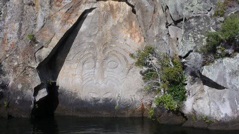 Panning motion towards Maori Rock Carving at lake Taupo in the North Island of New Zealand