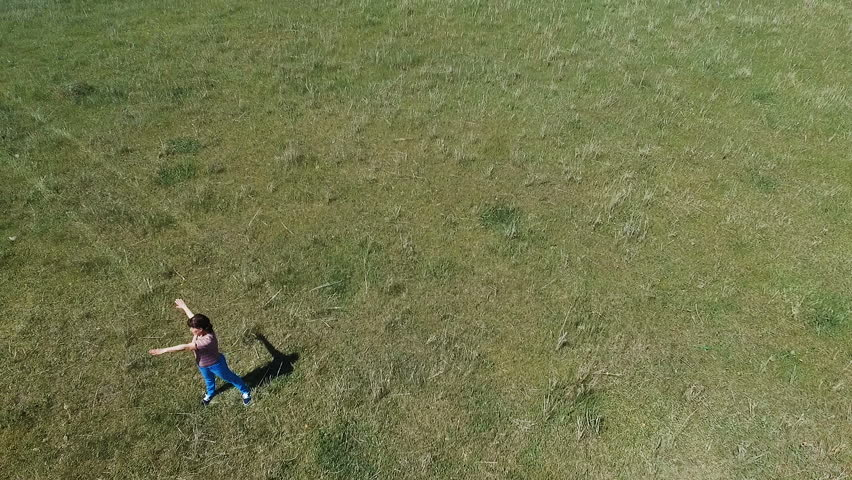 Woman exercising on green meadow | Shutterstock HD Video #26945269