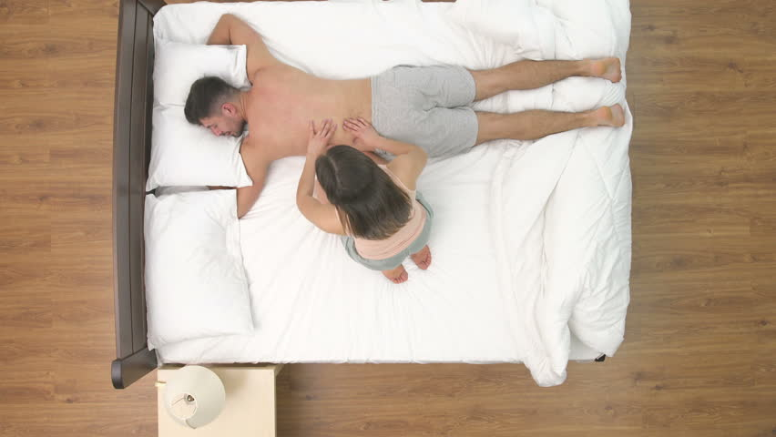 4k00 41the Woman Doing Massage To A Man In The Bed View From