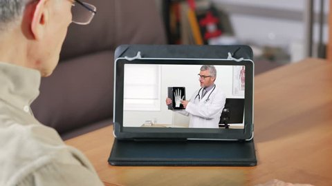 man listening doctor on video chat
