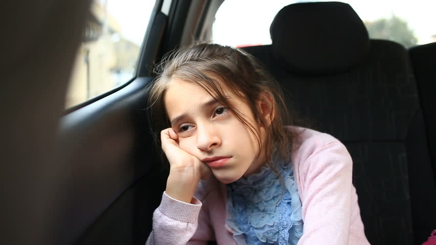 Little girl, bored in the car - looking out the window through the window - street reflection | Shutterstock HD Video #26981635