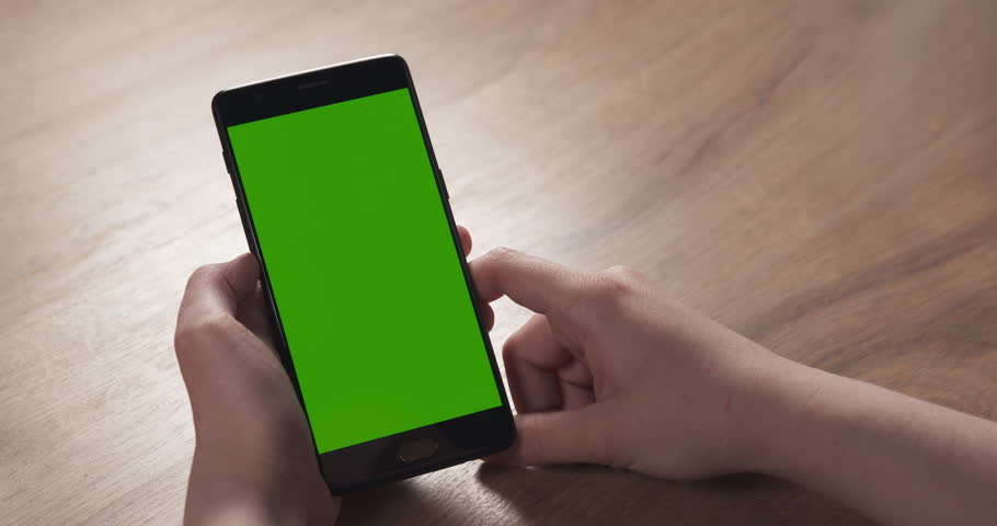 Slide shot of female teen girl using smartphone with green screen sitting at the table, 4k 60fps prores footage | Shutterstock HD Video #26992657
