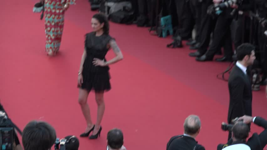 Aria Argento in black dress on the red carpet at the opening ceremony of Cannes 2017