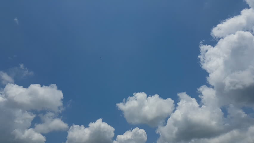 Time lapse clouds in the blue sky, used for background | Shutterstock HD Video #27015469