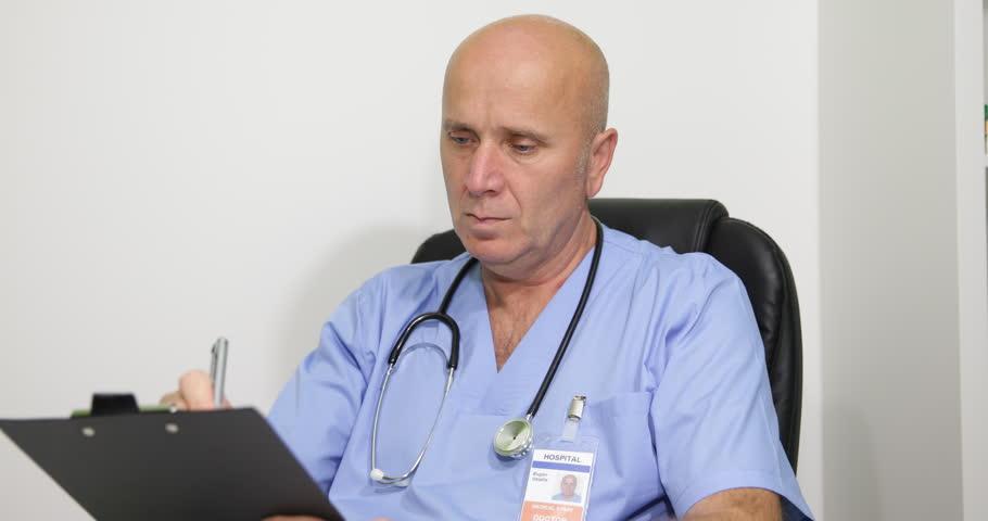 Pan View Doctor Man Writing Medical Prescription Healthcare Clinic  Consultation ( Ultra High Definition, UltraHD