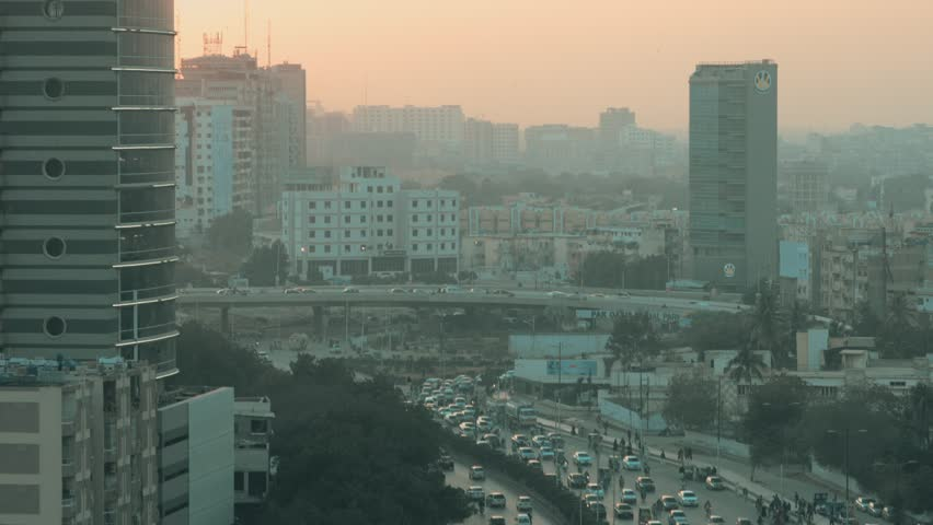 Shot of the metropolitan City Karachi in Pakistan. Cars, trucks, buses, rickshaws, high rise buildings all part of the busiest city in the country. 14th February 2017