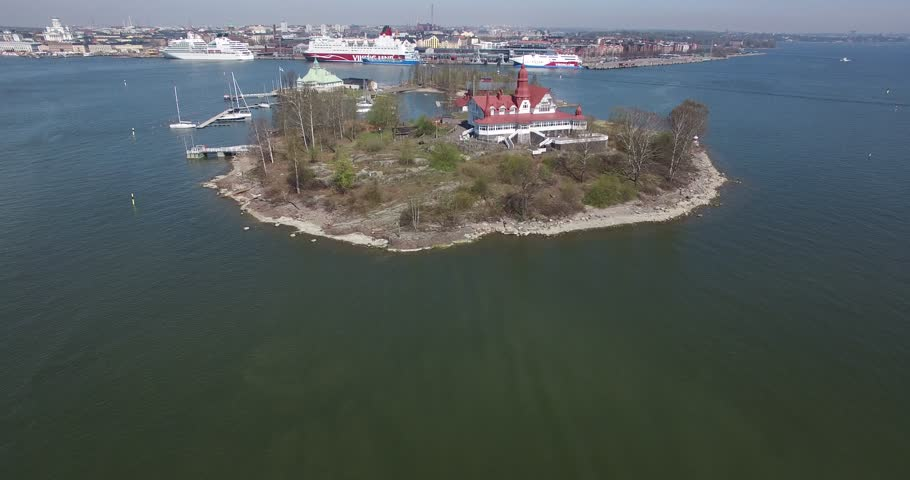 Aerial view drone footage of Helsinki bay area with boats and villas on islands near sea terminal and harbour with city skyline and Baltic Sea view in the capital of Finland, northern Europe