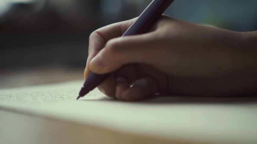 Hands of a woman writing on a piece of paper. Writing love letters.	 | Shutterstock HD Video #27041779