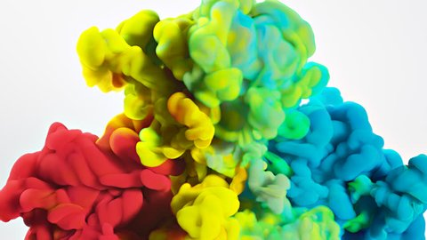 Colorful rainbow paint drops from bottom mixing in water. Ink swirling underwater. Cloud of silky ink isolated on white background. Colored abstract smoke explosion animation effect. Close up view.