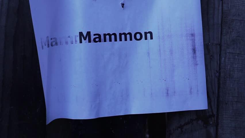Header of mammon