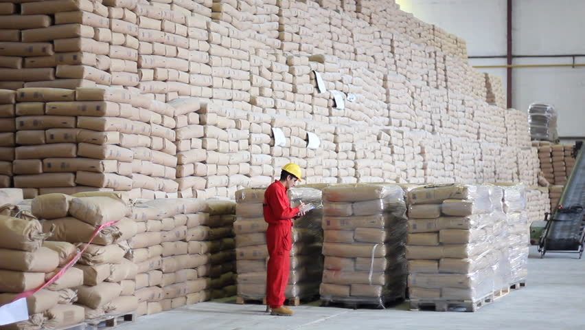 Worker controls of sugar bags in Warehouse