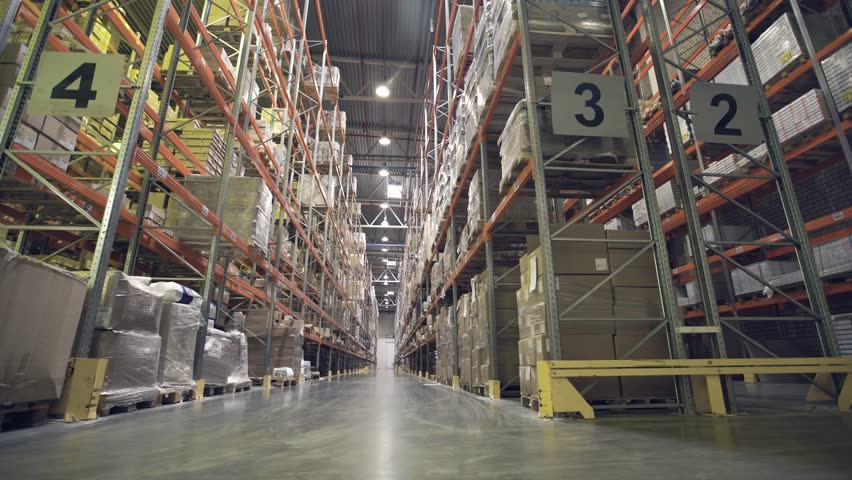 Interior of warehouse with racks full of cardboxes and goods