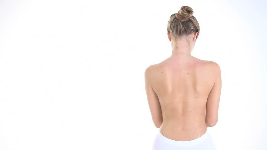 woman massaging her back, shoulders, neck