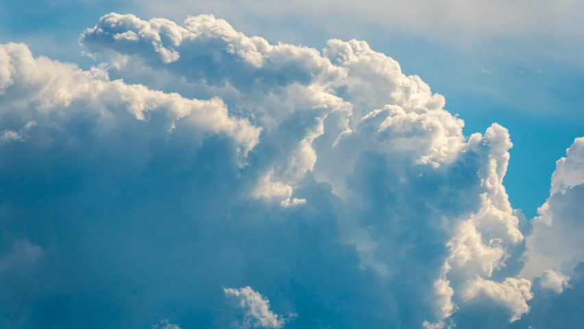 Blue sky white clouds background timelapse. Beautiful weather at cloudy heaven. Beauty of bright color, light in summer nature. Abstract fluffy, puffy cloudscape in air time lapse. High sunny cumulus.