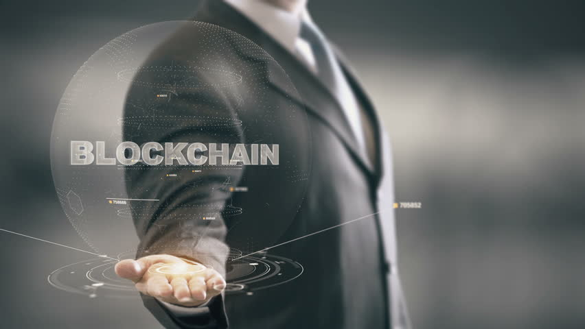 Blockchain with hologram businessman concept