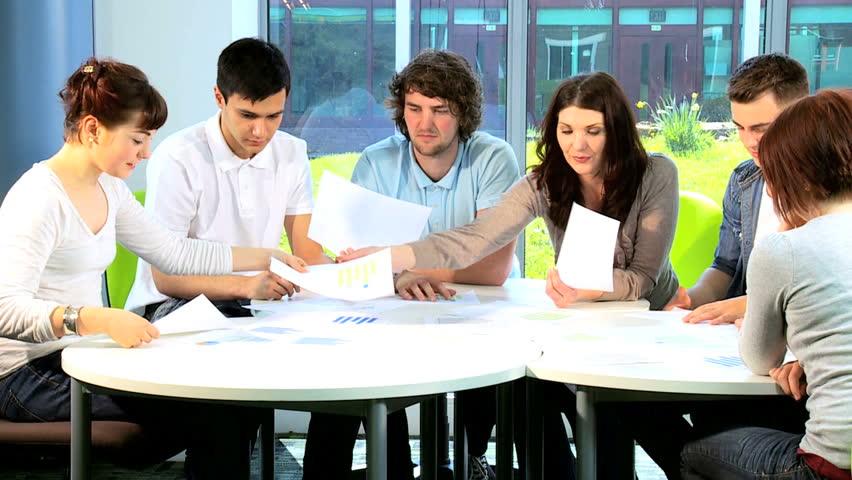 Female University Tutor Teaching Diverse Male And Female Graduate ...