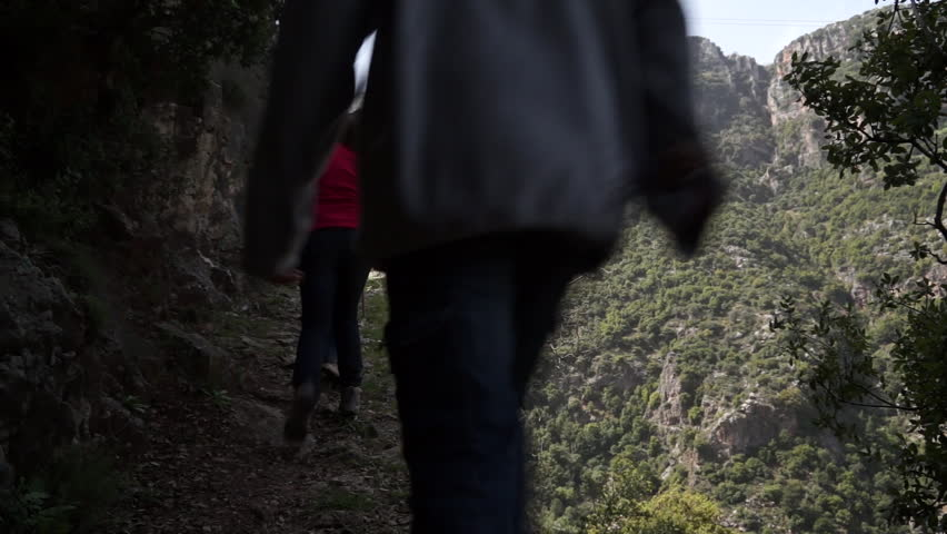Qadisha Valley, Lebanon. Static shot of hikers walking on a trail in Qadisha valley which is a deep gorge in north Lebanon and it is a Unesco site.