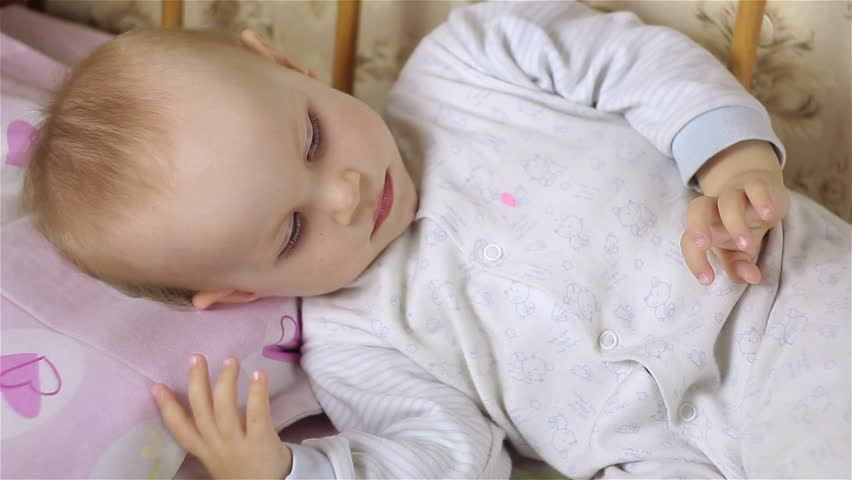Little baby girl is lying in bed.close-up. | Shutterstock HD Video #27368959