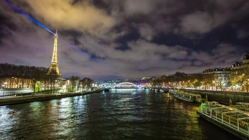 PARIS, FRANCE - JANUARY 2017: cloudy night famous paris riverside cityscape eiffel tower panorama 4k time lapse paris circa december 2017 paris, france. | Shutterstock HD Video #27395539