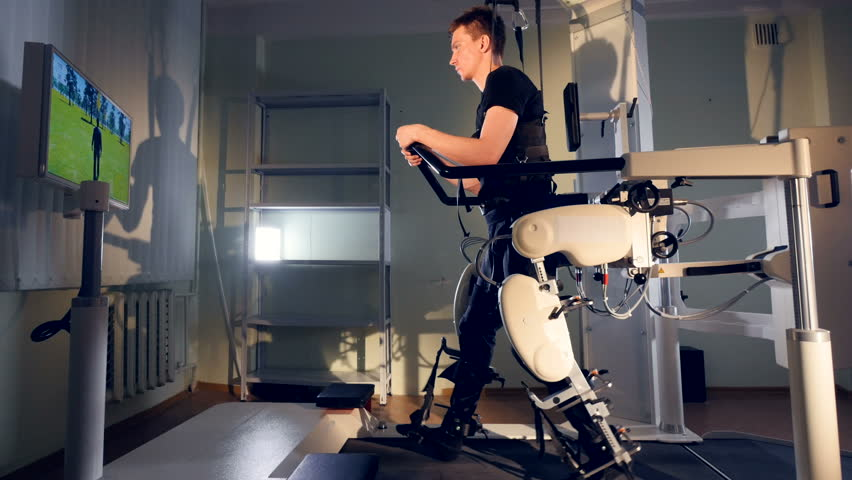 A patient during robot-assisted therapy with the Lokomat device.