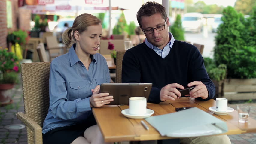 Business people working with documents and smartphone in cafe    Shutterstock HD Video #2740679