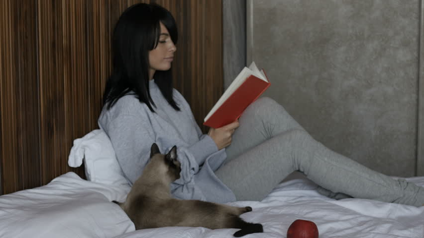 Woman With Cat Reading Book   4K Stock Video Clip Part 77