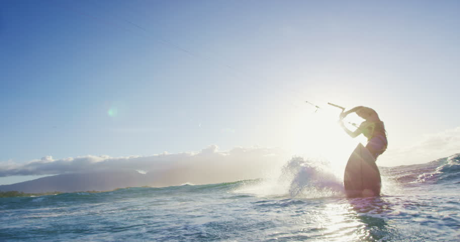 Young man kite surfing in blue ocean at sunset. Extreme sports summer. Shot on RED in 4k | Shutterstock HD Video #27430999