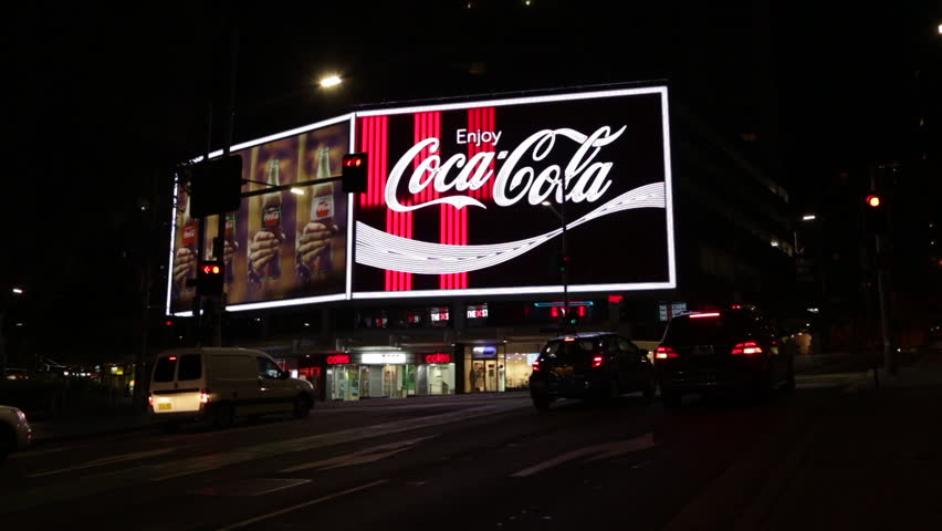 """The flashing neon sign of the Coca-Cola Billboard in Kings Cross, Sydney. It is known to by Sydneysiders simply as """"The Coke Sign"""". It is an iconic landmark and has historical value in the city."""