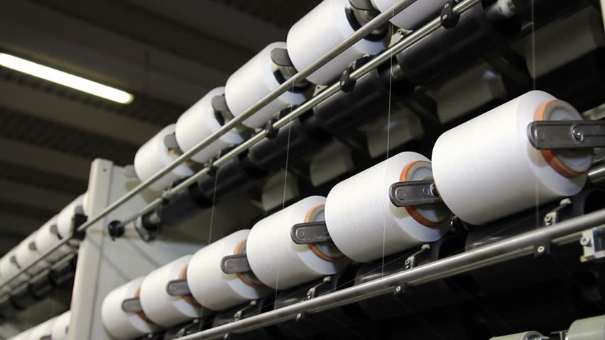 Production of Synthetic Fibers in the Textile Industry. Rows of automated machines for yarn manufacturing. Modern Textile Plant.    Shutterstock HD Video #27471259