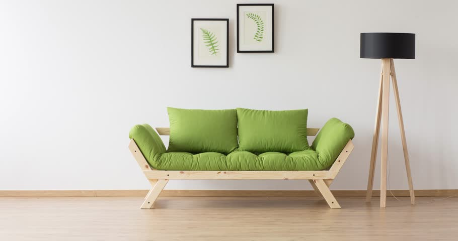 Two posters hanging on the wall above the green couch  | Shutterstock HD Video #27473809