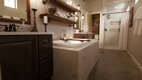 Master Bathroom Rise From Floor. rising shot in a modern master bathroom with a rustic industrial style